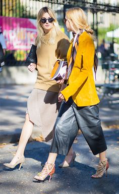 Yellow suede jacket, leather culottes, and embellished heels; Camel crew neck sweater, asymmetrical skirt, and nude pumps