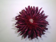 A personal favorite from my Etsy shop https://www.etsy.com/listing/226826003/big-adorable-flower-with-feather-and