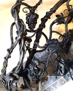Wrought Iron Art, LTD is Metal artist, handmade, artistic, ornamental, architectural, hot forging, iron sculpture, iron design, gates, railings, furniture, mailbox, wine cellar door, landscape