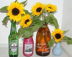 Sunflowers in alternative vases