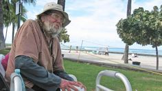 In this photo taken Sept. 8, Jim Trevarthen, 62, watches the surfers near Waikiki Beach in Honolulu. Hawaiian officials want to ban the homeless from tourist areas...the city may allow its homeless population to camp on Sand Island, a remote, mostly industrial island far from resorts that was used during World War II as a an Internment Camp for Japanese Americans...