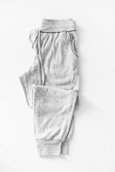 Super soft brushed knit sweatpants Adjustable and stretchy drawstring waistband Side pockets Stretchy lightweight knit material Available in Grey or Charcoal 60