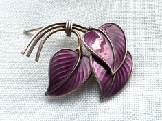Purple silver enamel brooch by Norwegian designer Albert Scharning. Read more about the designer at web page: http://solvstempler.no/albert_scharning.html