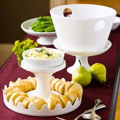 Give a fresh look to your classic serving dishes by elevating and stacking them. Raise a salad bowl on a shallow footed compote dish, or turn over a cake stand to serve bread and top with a dish of herbed butter! http://www.bhg.com/christmas/parties/holiday-buffet-serving-tips/?socsrc=bhgpin122814elevateandstackservingdishes&page=5