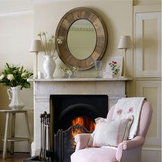 Focus the room with a centrepiece mirror | Cosy fireplace ideas - 10 of the best | housetohome.co.uk