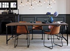 How about a little hardware with your dining table? An oxidized iron X-base provides support for solid (sustainable) mango wood planks while smaller touches of polished aluminum adds a hint of indu...