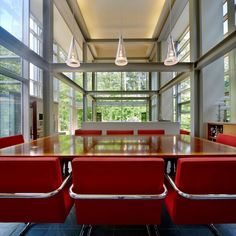 Home Design Charming Red Chairs Surrounded Wooden Table At Paletz Moi House Dining Room Near Three Cone Pendant Lamps Unique Home Design in the Middle of Dense Forest