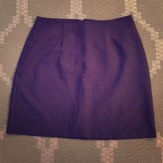 Purple mini skirt Purple mini skirt from XOXO. The skirt is 100% polyester, and has a zipper in the back. The skirt measures 16 inches from top to bottom and is a juniors size 7. In excellent condition! XOXO Skirts Mini