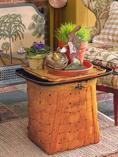 Top an oversize basket with a tray to create a coffee table, and then use pots and saucers to contain your Easter decor.
