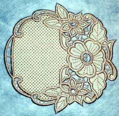 Advanced Embroidery Designs. Cutwork Flower Wreath coaster - instructions on how to embroider the machine designs.