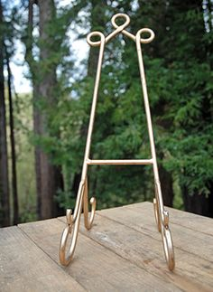 12.99 SALE PRICE! Use this Bronzed Metal Easel to hold table numbers or programs at your events. This large, sturdy easel makes a wonderful display for books...