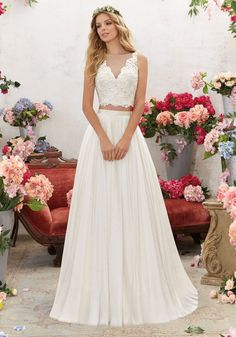 Perfect for the Boho Bride, This Two-Piece Wedding Dress Features a Crystal Beaded, Embroidered Bodice with Soft Net Skirt. Illusion Back Accented with Covered Button Detail