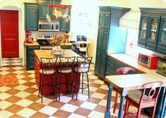 I love this kitchen. deep teal cabinets, red door and accents, checkerboard floor. would this work in my ranch home or is it too country? Kitschy Kitchen, Kitchen Remodel, Teal Cabinets, Cute Kitchen, Kitchen Flooring, Kitchen Colors, Red And White Kitchen, New Kitchen, Teal Kitchen