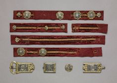 Section of belt with belt-fittings; velvet with gilt metal threads, silver gilt, enamel; two circular lobed belt-fitting with scalloped edges alternating with stylized leaves;  the floral motif in filigree enamel in translucent red, translucent green and opaque white.