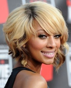 Inverted wavy bob layered hair style.