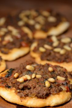 Lebanese sfeeha or sometime called lahm bi ajeen, which basically means lamb in dough, are amazing little meat pies that full of flavor and simply delicious. The dough is basically like a pizza dough and they are either served open face like a mini pizza or sometimes the meat is wrapped ...