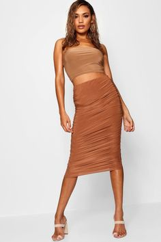 Click here to find out about the Corinna Soft Touch Slinky Rouched Midi Skirt from Boohoo, part of our latest Tonal collection ready to shop online today!