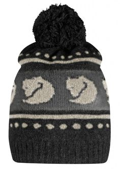Knitted hat with pom-pom in soft wool/polyamide blend. Comfortable for cold winter days, as the wool wicks away moisture and warms even when damp. Arctic fox pattern knitted around the outside, with ribbed edging. Lined with a band of fleece around the ea Fox Pattern, Pom Pom Hat, Outdoor Outfit, Knitted Hats, Knitting Patterns, Winter Hats, Beanie, Wool, Clothes
