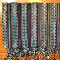 Blue Green Checker scarf from Nepal is one of many rewards you can reap. http://c-fund.us/83f