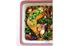 Spring onions and parsley give colour to roast chicken.