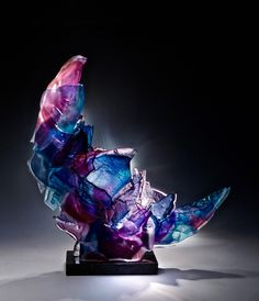 Nebo by Caleb Nichols. This breathtaking piece is created from blown glass forms that have been deliberately broken, then recombined and fused together into a sculpture that glows in the light. You'll want to display this work of art for everyone to see.