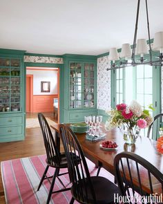 Cole & Son's Humming Birds wallpaper in the dining room with cabinets painted in Farrow & Ball's Minster Green. Table, chairs, and light fixture, Crate & Barrel. Rug, Patterson Flynn Martin.