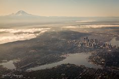 Seattle, taken by a guy on a flight inbound to SeaTac. We love this photo of the Seattle Area.. you might be able to make us out! ;)