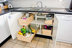 Make the space under your sink useful, rather than an ugly dumping ground. Build this under sink storage system to keep the clutter at bay.