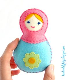 I create 2 felt baby rattles in shape of Russian doll matryoshka. There are 3 little bells inside the dolls. There are no small details on...