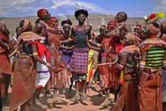 Rendille and Turkana tribes' people dance together before a solar eclipse in Sibiloi national Park, Kenya, Nov. 2013  - http://earth66.com/human/rendille-turkana-tribes-people-dance-solar-eclipse-sibiloi-national-park-kenya-nov-2013/