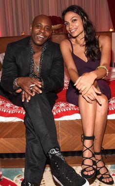 Dave Chappelle & Rosario Dawson from The Big Picture: Today's Hot Pics  The funny man and actress enjoy a laugh atMadonna's evening of music, art, mischief and performance to benefit Raising Malawiin Miami.