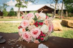 Gorgeous bouquet with blush pink and red!  Taken at THE SPRINGS in Tulsa by Epic Productions.