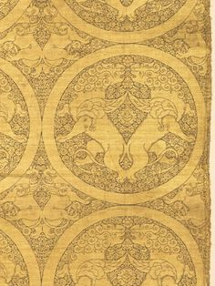 Yuan Dynasty. Cloth of gold with winged lions and griffons. Silk, gold thread; lampas weave. The motif of confronting lions in a medallion is constructed as a horizontal point repeat design unit of one half the image, flopped to compose the single medallion. This unit is then used as a straight repeat vertically. 124 x 48.8 cm. Purchase from the J. H. Wade Fund. The Cleveland Museum of Art.