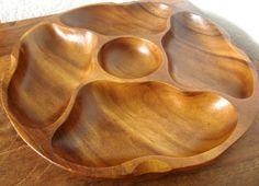 This vintage Danish design tray has a modern organic shape. It is hand carved of a single piece of teak wood. It has likely been made in the