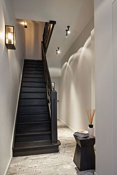 It may be small and narrow, but that doesn't mean your stairway can't get the same decorating treatment as the rest of your house. These staircase decorating ideas will give your entryway a step up. Find and save ideas about Painted stairs. Basement Stairs, House Stairs, Carpet Stairs, Black Stairs, Black Painted Stairs, Painted Staircases, Staircase Makeover, Staircase Remodel, Entry Hallway