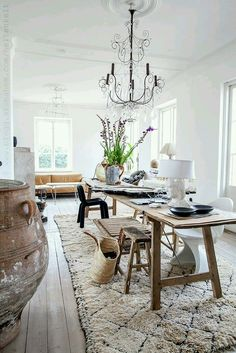 light - narrow table in the middle - one rug only - colour in the furniture