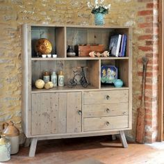 The Bainton wide display unit would make a stylish focal point in any living or dining room. It provides ample storage space, which is configured with two deep shelves and two square compartments at the top. Underneath there is hidden storage with a cupboard and three drawers which are finished with retro metal knobs.