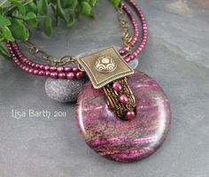 Purple and Bronze Woven Donut Necklace. $79.00, via Etsy.