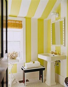 we already have a yellow bathroom, not too fond of it by itself but putting some vertical stripes may help!