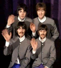 The Beatles waving. [GIF]