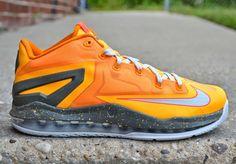 new styles ec741 f20e3 Nike LeBron 11 Low - Atomic Mango - Light Base Grey - Kumquat -  SneakerNews.com
