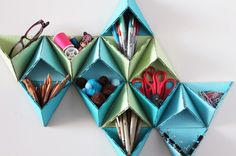 Triangular Wall Storage System - Use corrugated boxes to construct this DIY wall organizer.