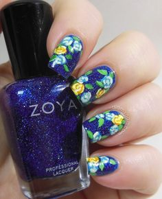 This design is SO NEAT with the glitter under the floral art.