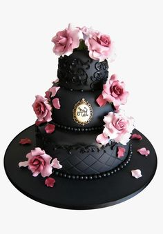 Black Icon Cake by Cakes Haute Couture -Where to find:  Pasteles & Cookies de Alta Costura  Description: Black chocolate cake decorated with sugar roses and monogram hand painted with edible gold.