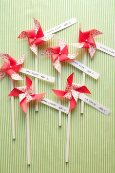 Pinwheel escort cards = whimsical idea for a summer or spring wedding.