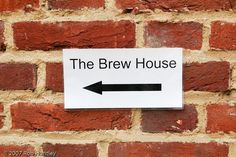 https://flic.kr/p/8U3wEj | Brew House this way | Brew House sign on a brick wall in Guildford in the United Kingdom.  Larger Version.  © Rob Huntley www.robhuntley.ca