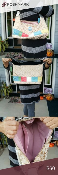 Coach shoulder bag. Multi color stripe Great bag with lots of color in traditional  coach pattern.  A must have for a Coach lover..a mark on bottom shows in pic used but in good condition Coach Bags Hobos