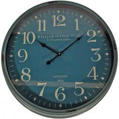 Lend Anglophile appeal to your den or parlor with this charming wall clock, crafted from metal and showcasing a blue hue. Product: Wall clockConstruction Material: Metal and glassColor: Blue