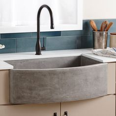 Never Let Anyone Tell You That Farmhouse Sinks Can't Be Contemporary // This farmhouse sink made from NativeStone, a combination of jute fiber and cement, adds a concrete touch to your kitchen.
