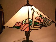 Unsigned ~ Beautiful pink roses with green leaves surrounded with iridescent and flourescent ivory panels ~ Base is bronze